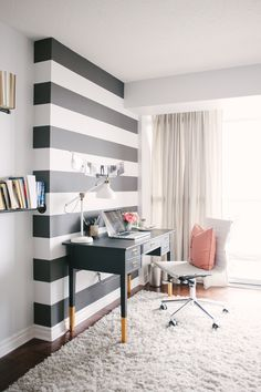 black and white striped wall in office / gold dipped desk legs