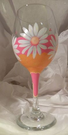 pretty colors. same concept on a 'kid' cup Daisy Wine Glass by GranArt on Etsy, $22.00 #paintedwineglasses