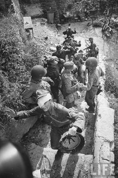 3rd-Infantry-1st-Armored, Cisterna, Italy, 1944. Checking German prisoners....