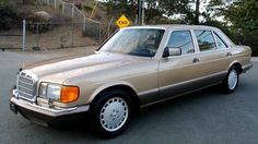 The attendant drove up in a (1986) Mercedes 420 Turbo Diesel. Bronze. He closed the door after each woman, and the black man gave him a tip.