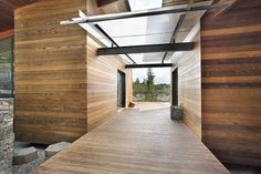 """Lovell Residence--#modern wood and glass breezeway by Quezada Architecture. """"The wood is redwood and it is finished with a clear penetrating sealer (TWP) so it is the natural color of the wood. Works well here as it is the north face of the house but if it gets a lot of sun exposure, it will eventually need to have a sealer that has color in it to protect it longer which we did on the south face."""""""