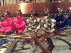 Clear gem studded earring posts with different shapes and sizes of polymer flowers dangling below. $6