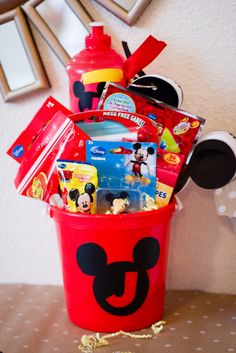 Fun favors in a bucket at a Mickey Mouse birthday party! See more party ideas at CatchMyParty.com!