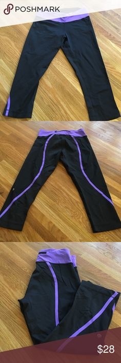 Lululemon Yoga Pants EUC Excellent used condition. Size 8. Stretchy and fitted.  Capri length black with purple trim and back zipper. A bit wrinkled from sitting in bottom of drawer a while but no visible wear. Hardly worn. lululemon athletica Pants Capris