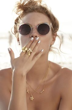 gold rings, gold necklace, cat eye glasses, silver nails