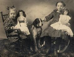 Vintage photo, two girls, two dolls, one dog.