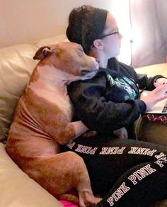 Photo of Shelter Dog Hugging New Owner Shows Exactly Why You ShouldAdopt