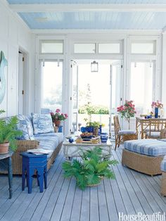 Designer Paula Perlin and architect Mark Ferguson created this idyllic blue porch for a house in Martha's Vineyard.