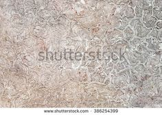 Abstract crackled texture background pattern in light gray and white colors, with rambling disordered spheres.