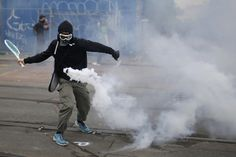 June 2016, a protester in Nantes uses a tennis racket to return a tear gas canister in a demonstration against proposed changes in French labor laws.