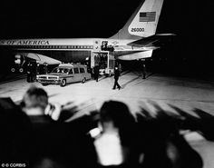 Sombre arrival: The body of President Kennedy is removed from the plane at Andrews Air Force base in D.C.