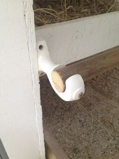 We used cheap curtain rod holders for our nesting box coop.