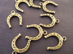 Antiqued Bronze Horseshoe Charms 12 pcs by AliCsSupplyShop on Etsy, $3.75