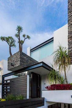 fachada: Casas de estilo Moderno por aaestudio