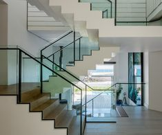 The stark, steel & glass, modernist staircase forms a central spine to this house and is offset by warm, natural Oak and painted, rough sawn Pine. Timber Staircase, Stairs, Pine, Warm, Steel, Natural, Glass, Projects, House