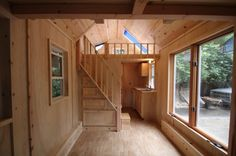 This is a recently completed home by Molecule Tiny Homes in Santa Cruz, California. It's 17-feet long and has a few notable features: a staircase to the loft, a bathtub, and a fold up porch. The whole thing is very nicely done, but those items really stand out in the crowd