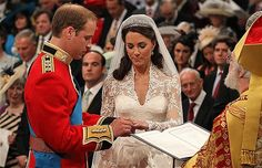Prince William (L) and Kate Middleton (C) exchange rings in front of ...