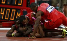 Members of the Trinidad and Tobago team celebrate their third place finish in the men's 4x400m relay final during the London 2012 Olympic Games
