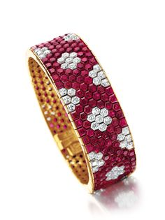 """Honeycomb"" motif ruby and diamond bracelet by Van Cleef & Arpels (pictured at left; estimate: $100,000-$150,000."