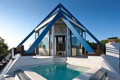 Amazing steel pyramid overlooks a massive swimming pool. Must be seen to be believed! Water Mill, NY | Douglas Elliman elliman.com