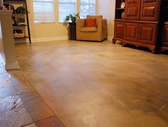 A concrete overlay was poured over this living room floor then stained to complement the nearby tile.