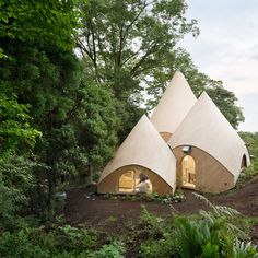 Teepee-shaped buildings by Issei Suma house community kitchen and spiral-shaped…