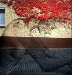 The red-haired woman: Beautiful! It is a work of Street Art, Germany