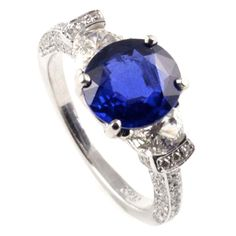 Platinum, Sapphire and Diamond Ring   From a unique collection of vintage three-stone rings at http://www.1stdibs.com/jewelry/rings/three-stone-rings/
