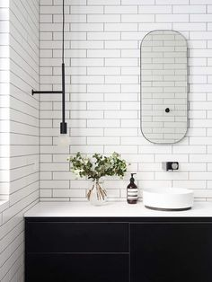 The owners of this renovated heritage cottage went for a classic yet modern look in their ensuite bathroom. In this space, the classic style of subway tiles is anchored by matt black finishes and black grout give the room a modern edge White Bathroom Tiles, Ensuite Bathrooms, White Bathrooms, Granite Bathroom, Concrete Bathroom, Shower Tiles, Luxury Bathrooms, Bathroom Mirrors, Dream Bathrooms