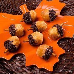"Your guests are in for a tasty surprise when they realize that these ""acorns"" are delectable doughnut holes!"
