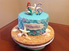 Little Mermaid Cake - Little Mermaid cake. Fondant scales, disco dust. Candy shells. Modeling chocolate rock. Dragees.