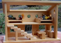 the kids would love this - finally a dolls house appropriate for boys and girls!!! ~ Wooden Dollhouse