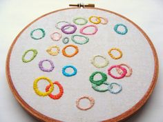 Hand Embroidered Colorful Wall Art - Circles, home decor, great for baby shower gift, nursery room, hoop wall art, custom work available. $26.00, via Etsy.
