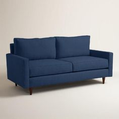 Handcrafted in the U.S.A. with chunky, textured upholstery, our custom-made sofa boasts clean lines, subtly flared arms, piping detail and tapered cone legs in a rich walnut finish. This affordable, contemporary seat features sinuous springs for added comfort and reversible soybean foam cushions.