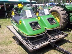 Pair of John Deere snowmobiles