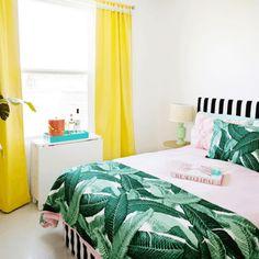 bedroom with banana leaf print and bright yellow curtains, pantone meadowlark, lemon yellow