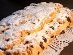 Dresdner Stollen is the famous fruitcake from Dresden that is sold throughout Germany during the Christmas season. Stollen is a rich yeast dough mixed with candied fruit and almonds. Christmas Stollen Recipe, Christmas Bread, German Christmas, Christmas Cooking, Christmas Desserts, Christmas Fruitcake, Christmas Holiday, Christmas Markets, Christmas Foods