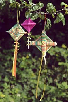 lollipop stick and yarn kites. great idea for the kids to make and hang in the garden.