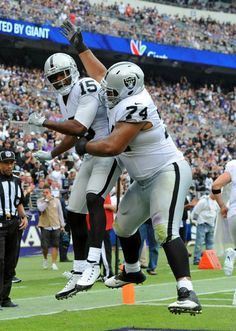 Oakland Raiders wide receiver Michael Crabtree (15) celebrates his touchdown with teammate Vadal Alexander in the first half of an NFL football game against the Baltimore Ravens, Sunday, Oct. 2, 2016, in Baltimore.