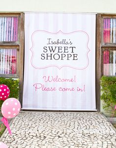 I have always wanted to host a Sweet Shop Party! This one is pretty darn cute! Huge custom made door sign - made using a printable sign from Chickabug