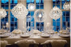 Beautiful wedding decorations! Love the chandelier-inspired lighting and the crystal!