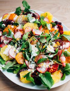A wintry orange and arugula salad scattered with citrus-marinated radishes and drizzled with creamy buttermilk ranch dressing.