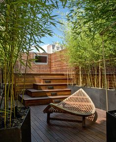 Offering a spa-like zen appeal, the unified palette of natural materials gives this outdoor space a sense of calm.