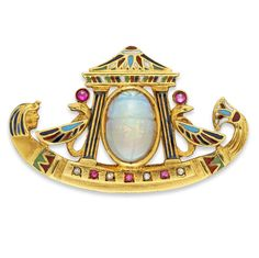 A Victorian Egyptian Revival gold, enamel and gem-set galley brooch, circa 1880. The carved opal scarab measuring approximately 12.20 x 8.20 mm set to the centre of an Egyptian style gold, enamel and gem-set galley, with engraved gold back and brooch fitting. #Victorian #EgyptianRevival #brooch