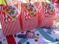 Favors: Cute idea for favor wrap.  Tags strung with ribbon bow OR flap label stapled across top.