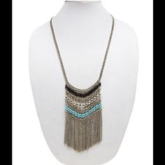 """NEW Boho Bead Fringe Necklace Boho babes rejoice! This bold necklace is the perfect finishing touch for the days you want to make a statement. The necklace has rows of beads, chains, and chain-link fringe hanging in a tribal-inspired design from the center.  Lobster Clasp 28"""" Length / 5.5"""" Drop Man Made Materials / Metal Jewelry Necklaces"""