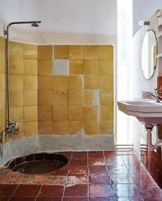 rustic bathroom with yellow and red tile. / sfgirlbybay