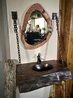 This natural wood slab vanity features a bigleaf maple wood slab with a great grayish black live edge. This rustic vanity also has a hammered copper vessel Rustic Bathroom Designs, Bathroom Design Luxury, Rustic Bathrooms, Interior Design Pictures, Rustic Vanity, Beautiful Home Gardens, Bathroom Sink Faucets, Sinks, Log Furniture