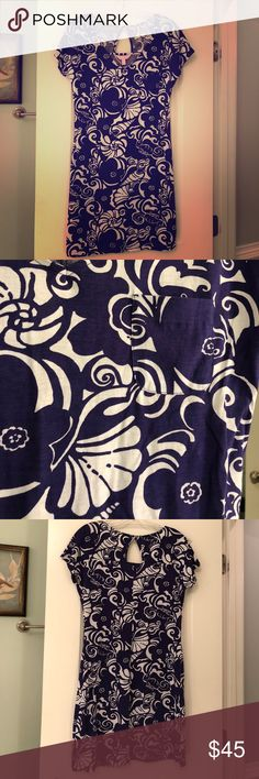 Purple Lilly dress. Dress photographs darker but used a filter on 1st pic to more closely resemble the purple.  It's the color of ECU Pirate purple or Minnesota Vikings purple Lilly Pulitzer Dresses