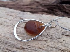Sea glass jewelry  Brown sea glass suspended by FatCatsOnTheBeach, $25.00